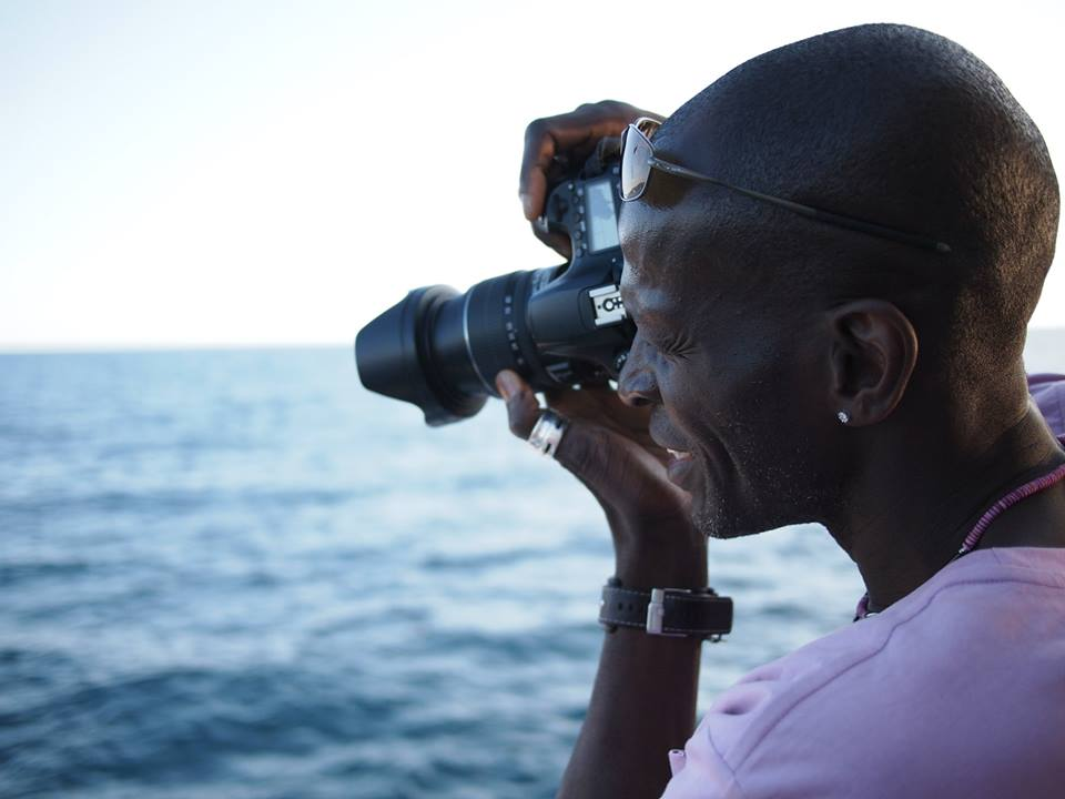 Photographer in action — with Olu Olu by Harry Limsky